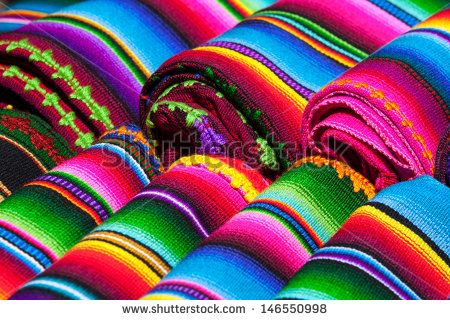 stock-photo-colorful-mexican-blankets-for-sale-at-market-latin-america-mexico-travel-background-146550998